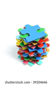 Stack of Jigsaw Puzzle Pieces on White Background