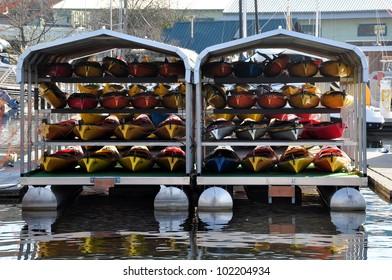 Stack of kayaks on a floating pontoon