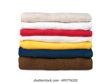 Stack of knitted clothes isolated on white. Stacked folded winter clothing.