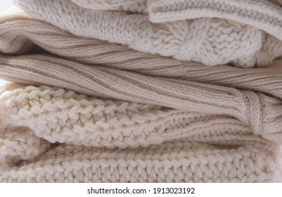 A stack of knitted sweaters, cotton. closeup