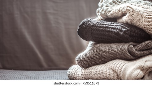 A stack of knitted sweaters ,the concept of warmth and comfort, hobby , background,closeup