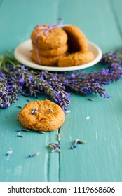 stack of lavender cookies on enamel plate, aged blue wooden table
