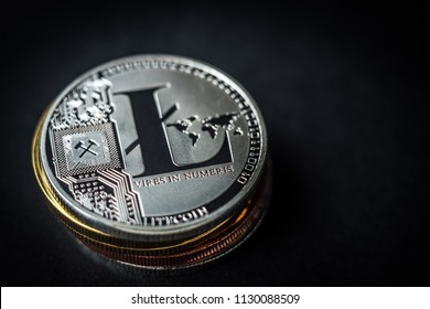 Stack of litecoin coin lying on dark background, copyspace