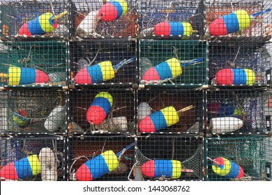 Stack of lobster traps with colorful buoys