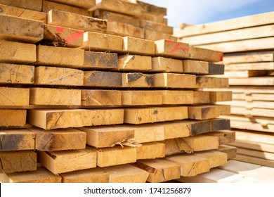 Stack of lumber wooden beams prepared to build a house