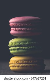 Stack of macaroons on dark background