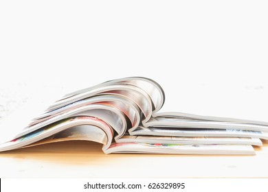 stack of magazine open on table with white background. copy space.
