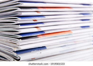A stack of magazine spines with copy space.