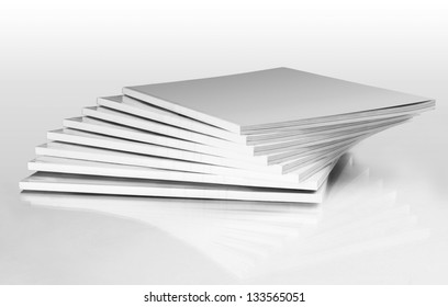 Stack of magazines with a blank cover, isolated on white