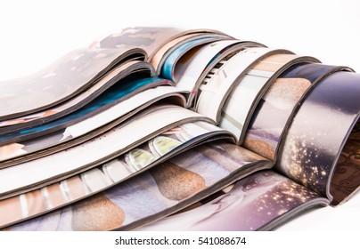 Stack of magazines isolated on white.....