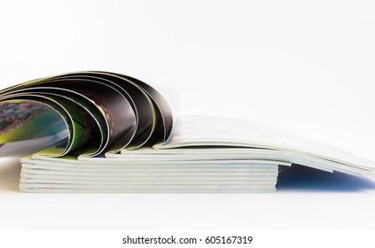 Stack of magazines isolated on white background.
