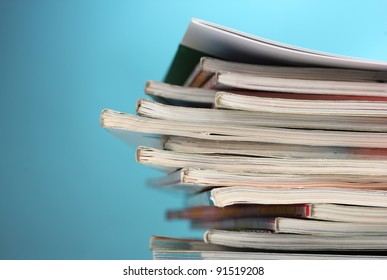 stack of magazines on blue background