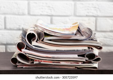 Stack of magazines on table, close up