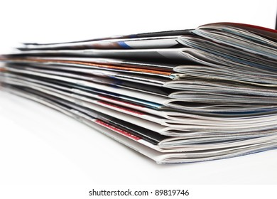 a stack of magazines on white