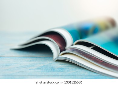 Stack magazines on wooden table