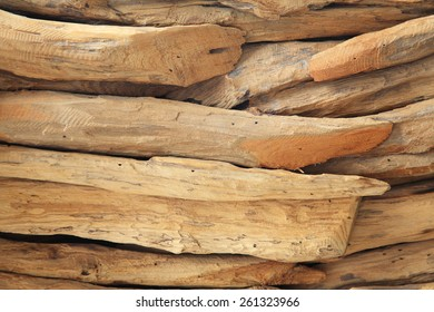 Stack of many small wooden pieces arrange for decoration. Texture background