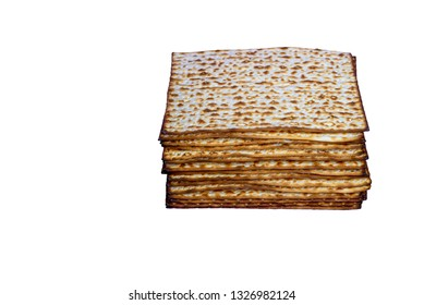 Stack of Matzah on a white isolated background. Pile of Matza -Jewish traditional Passover unleavened bread. Pesach celebration symbol.