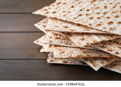 Stack of matzos on wooden table, closeup