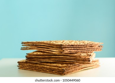 Stack of matzot (matzah - unleavened bread). Symbol of jewish  traditional Passover. Matza - Pesach celebration food.Copy space.