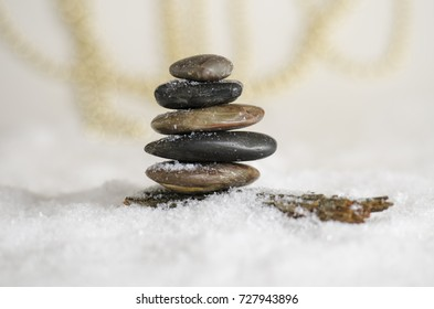 Stack of meditative rocks in the snow