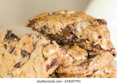 Stack of Melted Gooey Chocolate Chip Cookies for Dessert with Milk