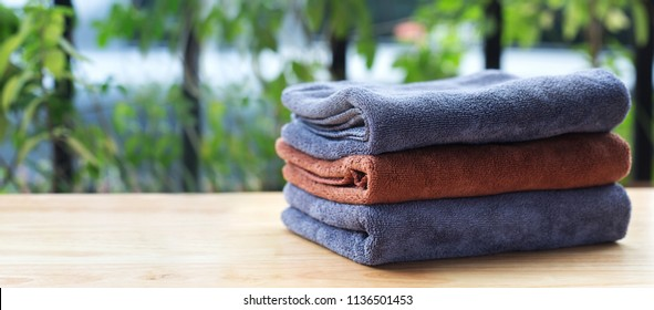 Stack of microfiber cloth on table with copy space.
