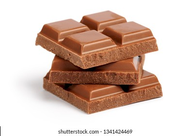 Stack of milk chocolate bar pieces isolated on white background
