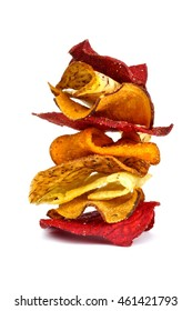 Stack of mixed healthy vegetable chips isolated on a white background