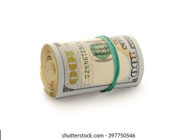 Stack of money dollars bounded by rubber band isolated on a white background