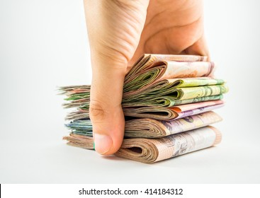 Stack of money in hand isolated on white background