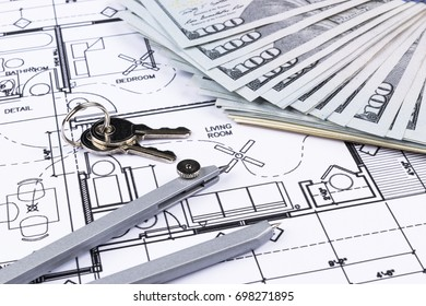 Stack of money with key lying on construction drawing of house, blueprint house plan concept, money for new real estate. blueprint and  drawing instruments on the worktable.