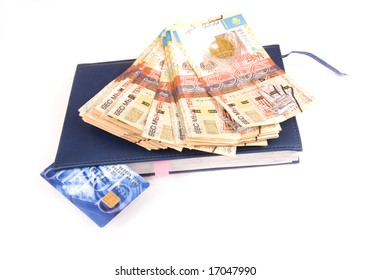 Stack of money or one credit card and notebook, isolated, white, finance