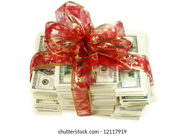 Stack of money wrapped in red bow and ribbon