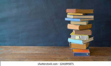 Stack of multicolored books, panorama, education,reading,back to school concept, good copy space
