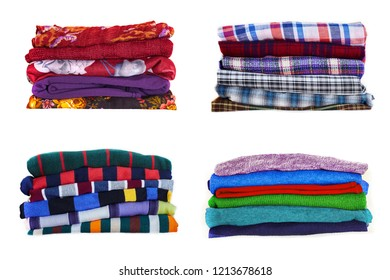 Stack of multicolored clothes isolated on white background. Collection of clothes in different colors and textures on a white background