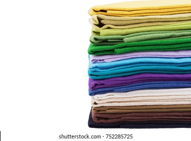 Stack of multicolored linen fabric, side view isolated on white