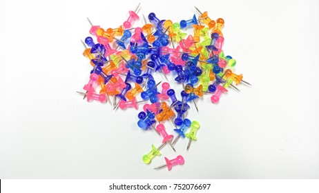 Stack of multicolored paper on white background.