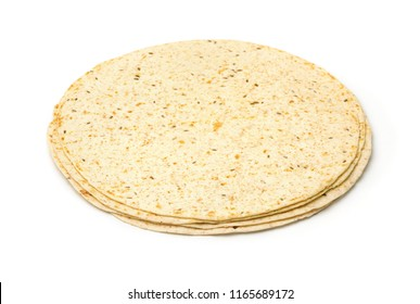 Stack of multigrain tortillas with bran and flax seeds isolated on white