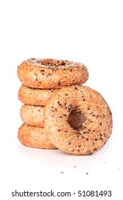 Stack of multi-seeded bagels with focus on the front one