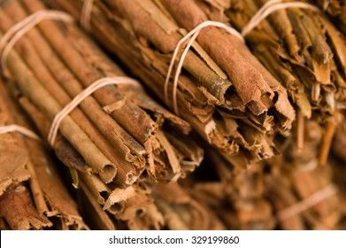 Stack of neatly bundled cinnamon for sale
