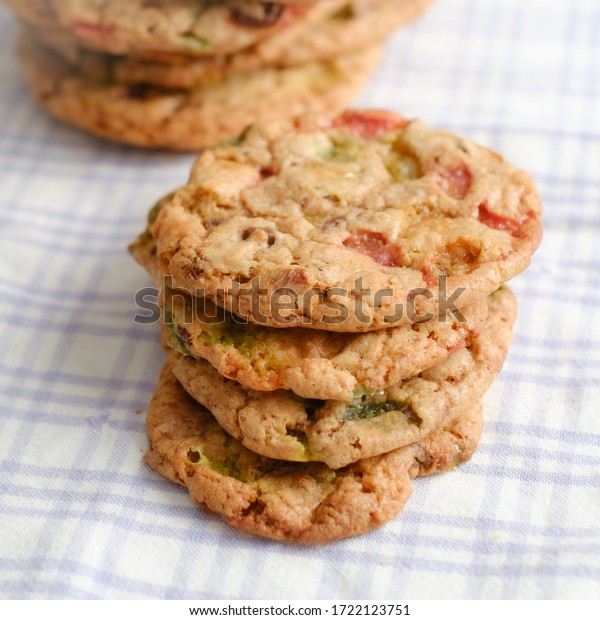 Stack of new baked cookies on tablecloth