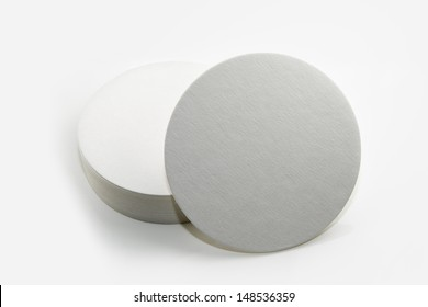 Stack of new beer coasters isolated on a white background. Add your own design or logo.