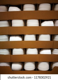 Stack of new and clean white bolw in container