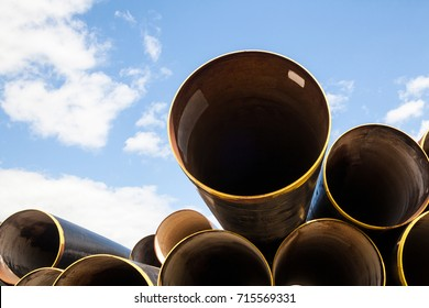 Stack of new metal pipes. Industrial material.