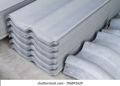 Stack of new roof tiles sheet Asbestos Concrete fiber cement and Siding Standard gray color.