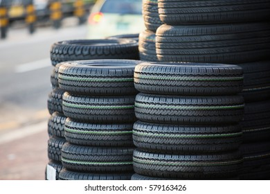 Stack of new tires on the street.