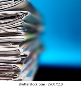 Stack of newspaper on blue background