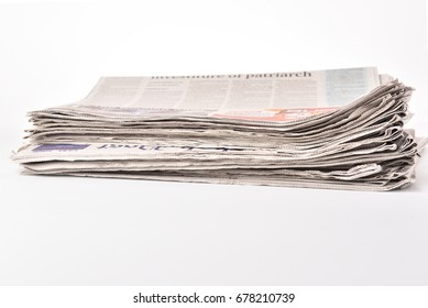 Stack newspaper pace on white isolated bakcground