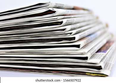 stack of newspapers Business information