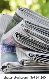 stack of newspapers in close up view,